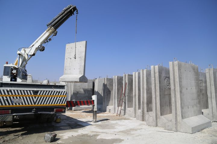 A wall is built along the Turkish-Syrian border, as taken in Hatay, Turkey, on Aug. 13, 2015.