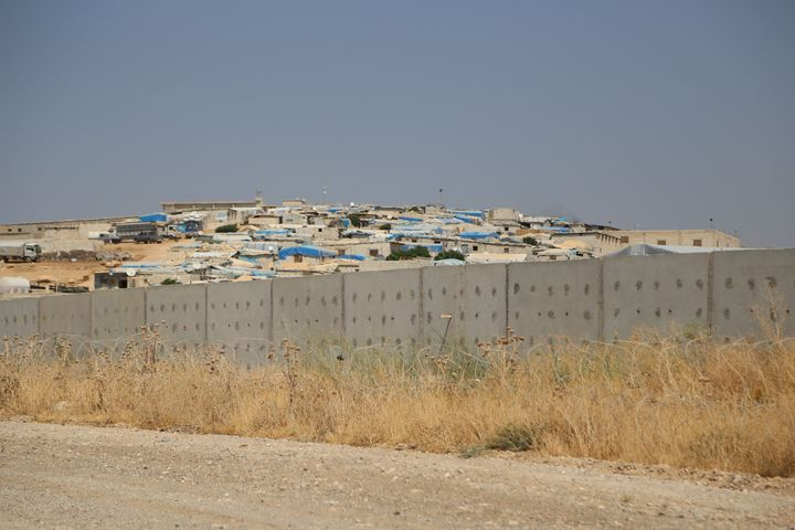 A 3-meter-high and 2-meter-wide wall sits along the Turkish-Syrian border on Aug. 13, 2015, as taken from Hatay, Turkey.