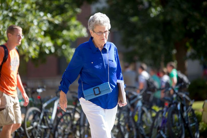 Jean Kops walks across the UNL campus after her morning classes in 2013.