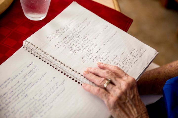 Jean Kops reviews some of her notes from class at her kitchen table.