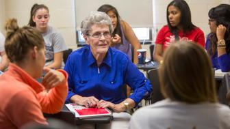 <p>Jean Kops sits surrounded by younger students in a sociologyclass in September 2013.</p>