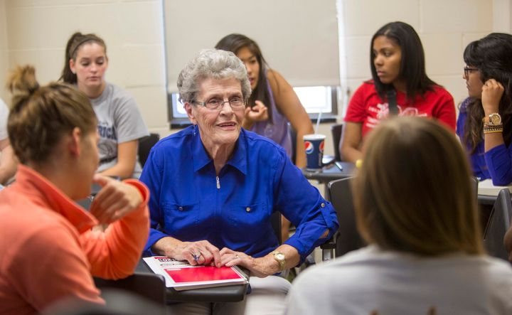 Jean Kops sits surrounded by younger students in a sociology class in September 2013.