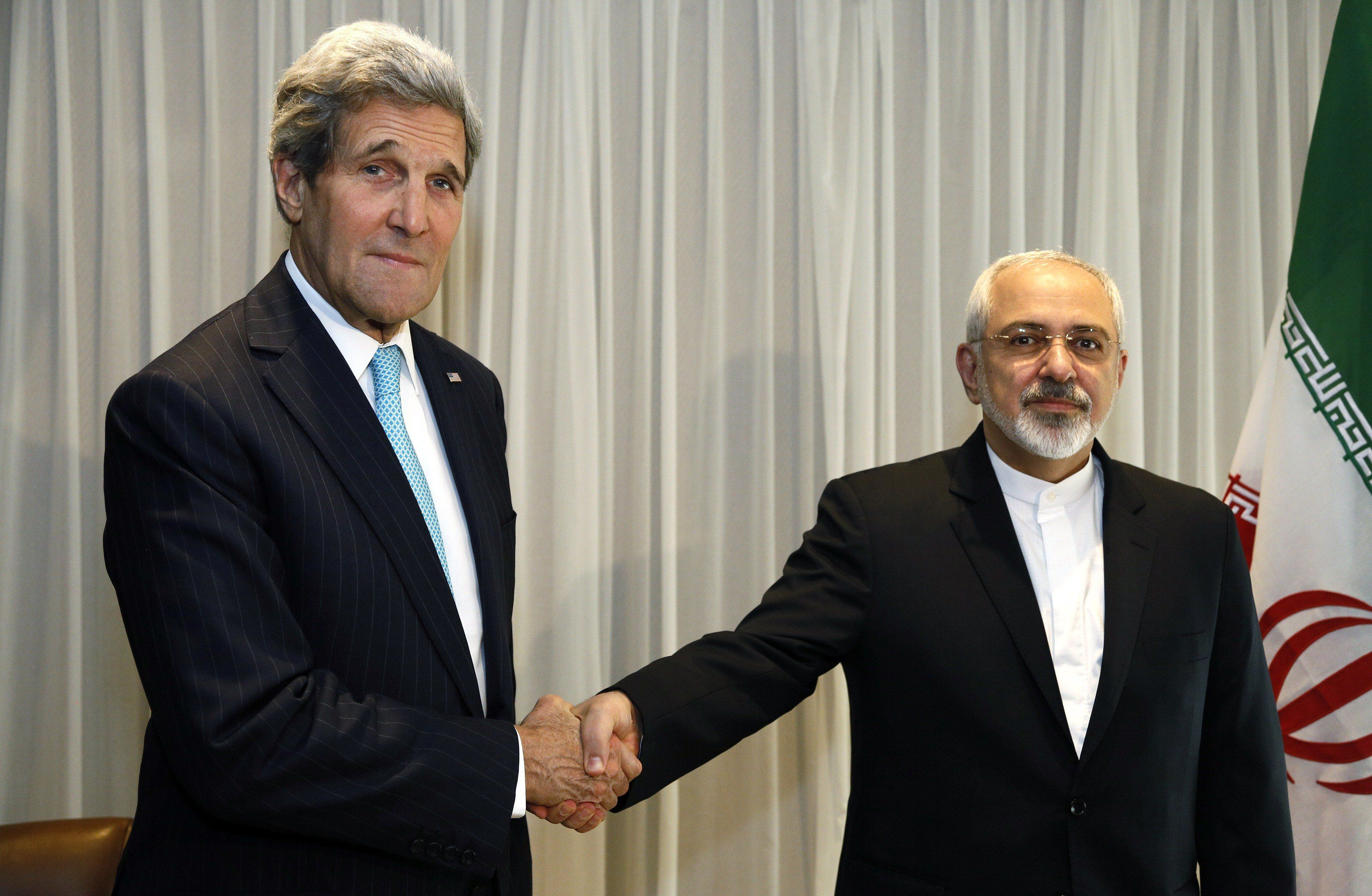 <span>Iranian Foreign Minister Mohammad Javad Zarif shakes hands with Secretary of State John Kerry in Geneva on Ja
