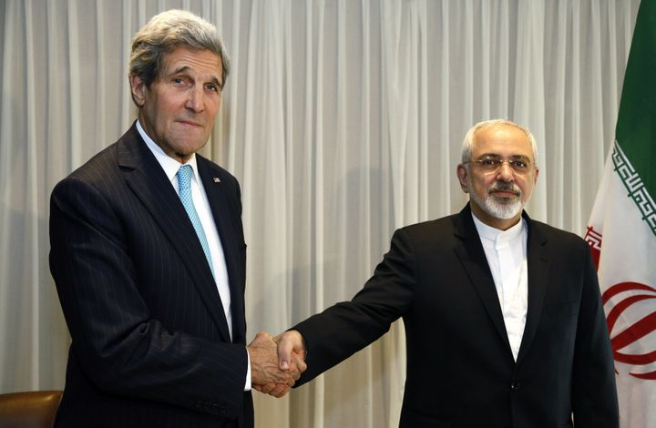 <span>Iranian Foreign Minister Mohammad Javad Zarif shakes&nbsp;hands with Secretary of State&nbsp;John Kerry in Geneva on Ja
