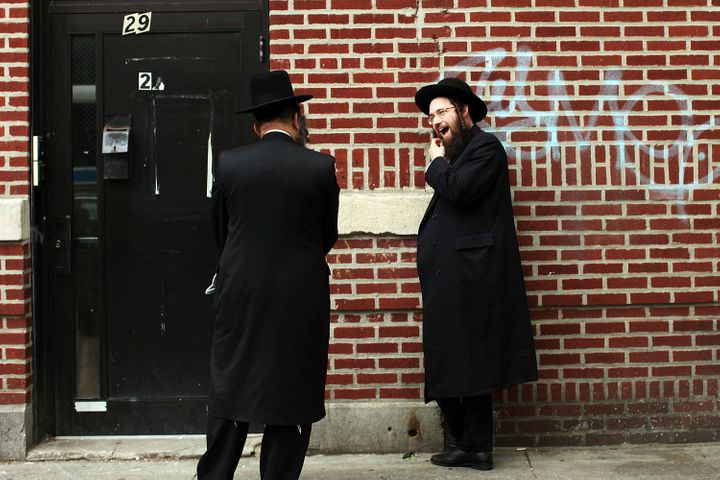 <span>Members of the Jewish Orthodox community talk on a street in a Brooklyn neighborhood on June 14, 2012 in New York City.