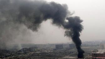 TIANJIN, CHINA - AUGUST 15: (CHINA OUT) A cloud of smoke rises at blast site three days after warehouse explosion on August 15, 2015 in Tianjin, China. Over 700 injured and evacuated people have been settled at emergency shelter in Binhai New Area after Wednesday explosion of a warehouse in Tianjin. The death toll rose to 85 Friday evening, and 21 of whom were firemen, local authorities said. (Photo by ChinaFotoPress/ChinaFotoPress via Getty Images)