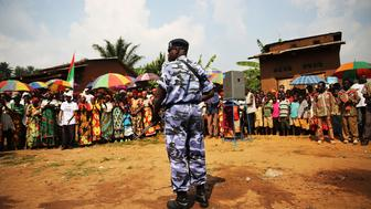 MPANDA, BURUNDI - JUNE 23:  A member of an elite police force stands guard as a member of the ruling party, the National Council for the Defense of Democracy-Forces for the Defense of Democracy (CNDD-FDD), speaks on June 23, 2015 in Mpanda, Burundi. The head of Burundi's influential rights group, Aprodeh, says at least 70 people, mostly civilians, have been killed and hundreds of others wounded following weeks of political unrest in the small, impoverished country in the African Great Lakes region of East Africa. The violence started after President Pierre Nkurunziza announced his controversial bid for a third consecutive five-year term in office. The Office of the UN High Commissioner for Refugees (UNHCR) has said the violence in Burundi has forced more than 100,000 people to flee to neighboring countries.  (Photo by Spencer Platt/Getty Images)