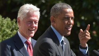 Former US president Bill Clinton laughs while US President Barack Obama speaks during the AmeriCorps Pledge ceremony on the South Lawn of the White House on September 12, 2014 in Washington, DC. The ceremony marks the 20th anniversary of the national service program which was established by Clinton. AFP PHOTO/Mandel NGAN        (Photo credit should read MANDEL NGAN/AFP/Getty Images)