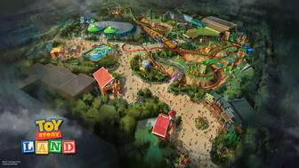UNSPECIFIED - AUGUST 14: In this handout photo provided by Disney Parks, Toy Story Land at Disney's Hollywood Studios in Florida is seen. The reimagining of Disney's Hollywood Studios will take guests to infinity and beyond, allowing them to step into the worlds of their favorite films, starting with Toy Story Land. This new 11-acre land will transport guests into the adventurous outdoors of Andy's backyard. Guests will think they've been shrunk to the size of Woody and Buzz as they are surrounded by oversized toys that Andy has assembled using his vivid imagination.  Using toys like building blocks, plastic buckets and shovels, and game board pieces, Andy has designed the perfect setting for this land, which will include two new attractions for any Disney park and one expanded favorite. (Photo by Disney Parks via Getty Images)