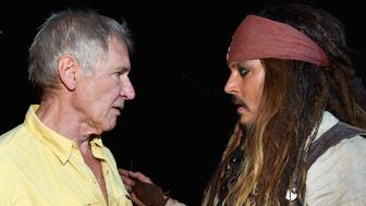 ANAHEIM, CA - AUGUST 15:  Actors Harrison Ford of STAR WARS: THE FORCE AWAKENS (L) and Johnny Depp, dressed as Captain Jack Sparrow, of PIRATES OF THE CARIBBEAN: DEAD MEN TELL NO TALES took part today in 'Worlds, Galaxies, and Universes: Live Action at The Walt Disney Studios' presentation at Disney's D23 EXPO 2015 in Anaheim, Calif.  (Photo by Alberto E. Rodriguez/Getty Images for Disney)