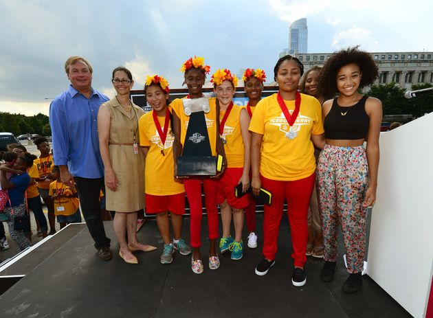 Amandla Stenberg (far right) on stage with ComEd CEO Anne Pramaggiore, COO Terence Donnelly, and the winning team -- Flaming Zing -- at the Field Museum in Chicago. Each participant in the derby received $1,000 in scholarship money and the winning team received a MacBook Air and all-expenses-paid admission to a weeklong technology camp.