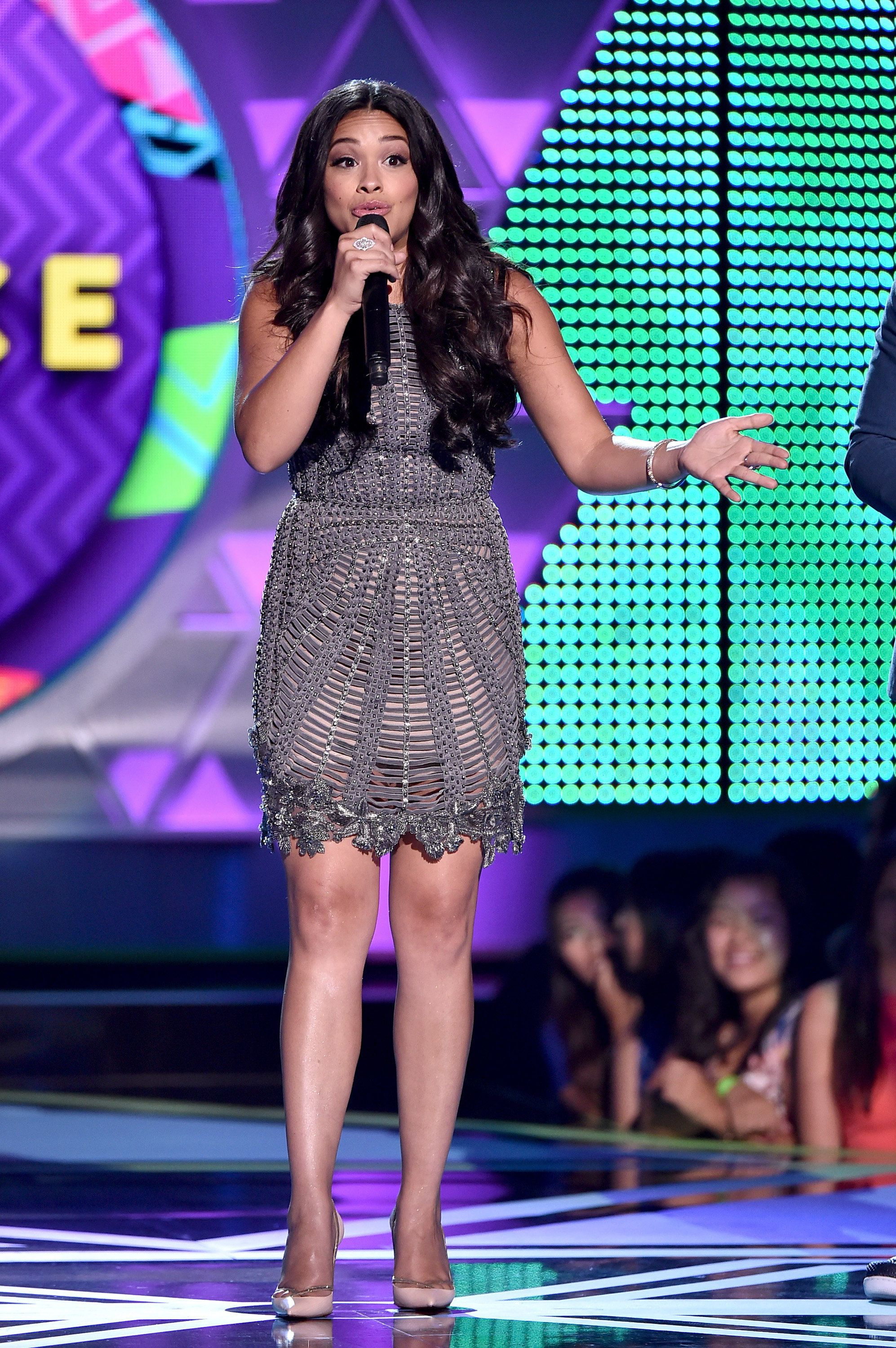 LOS ANGELES, CA - AUGUST 16: Co-host Gina Rodriguez speaks onstage during the Teen Choice Awards 2015 at the USC Galen Center on August 16, 2015 in Los Angeles, California.  (Photo by Kevin Winter/Getty Images)