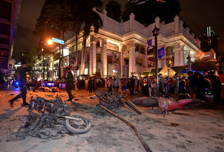 <span>Thai soldiers inspect the scene after a bomb exploded outside a religious shrine in central Bangkok late on August 17,