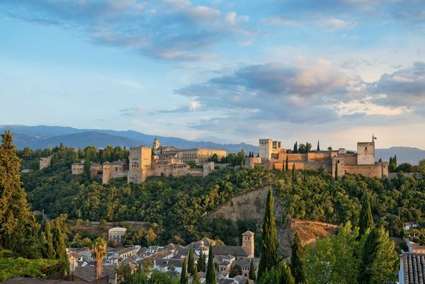 With sheer red walls set against a mountain backdrop, the palace complex dominating Granada's skyline is perhaps the mo
