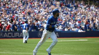 TORONTO, ON - AUGUST 16  - Blue Jays Jose Bautista runs to 1st base after hitting a 2 run home run during the 3rd inning of their baseball game as the Toronto Blue Jays take on the New York Yankees at Rogers Centre on   August 16, 2015. Carlos Osorio/Toronto Star        (Carlos Osorio/Toronto Star via Getty Images)