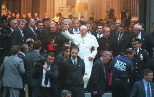 Pope John Paul II leaves St. Patrick's Cathedral on Oct. 7, 1995, in New York surrounded by security and police as he heads f