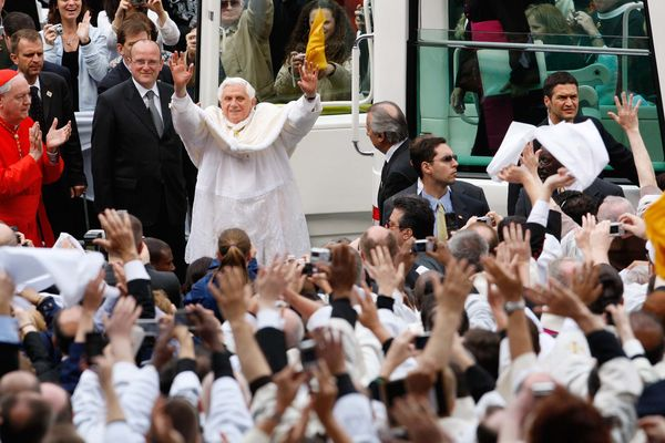Pope Benedict XVI waves to supporters after exiting the popemobile at Yankee Stadium in the Bronx borough of New York, U.S.,