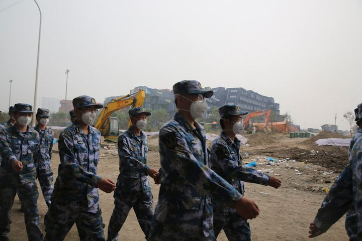 Representatives of People's Liberation Army and public security attend the mourning for the dead in Tianjin warehouse explosi