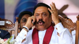 KANDY, SRI LANKA- AUGUST 14 : Former Sri Lankan president and parliamentary candidate Mahinda Rajapaksa talks on phone during his party's rally on the final day of election campaign on August 14, 2015 in Kandy, Sri Lanka. Sri Lanka's Election Commission has scheduled the polls on August 17, 2015, after Sri Lankan President Maithripala Sirisena has dissolved the parliament on June 26, 2015.  (Photo by Buddhika Weerasinghe/Getty Images)
