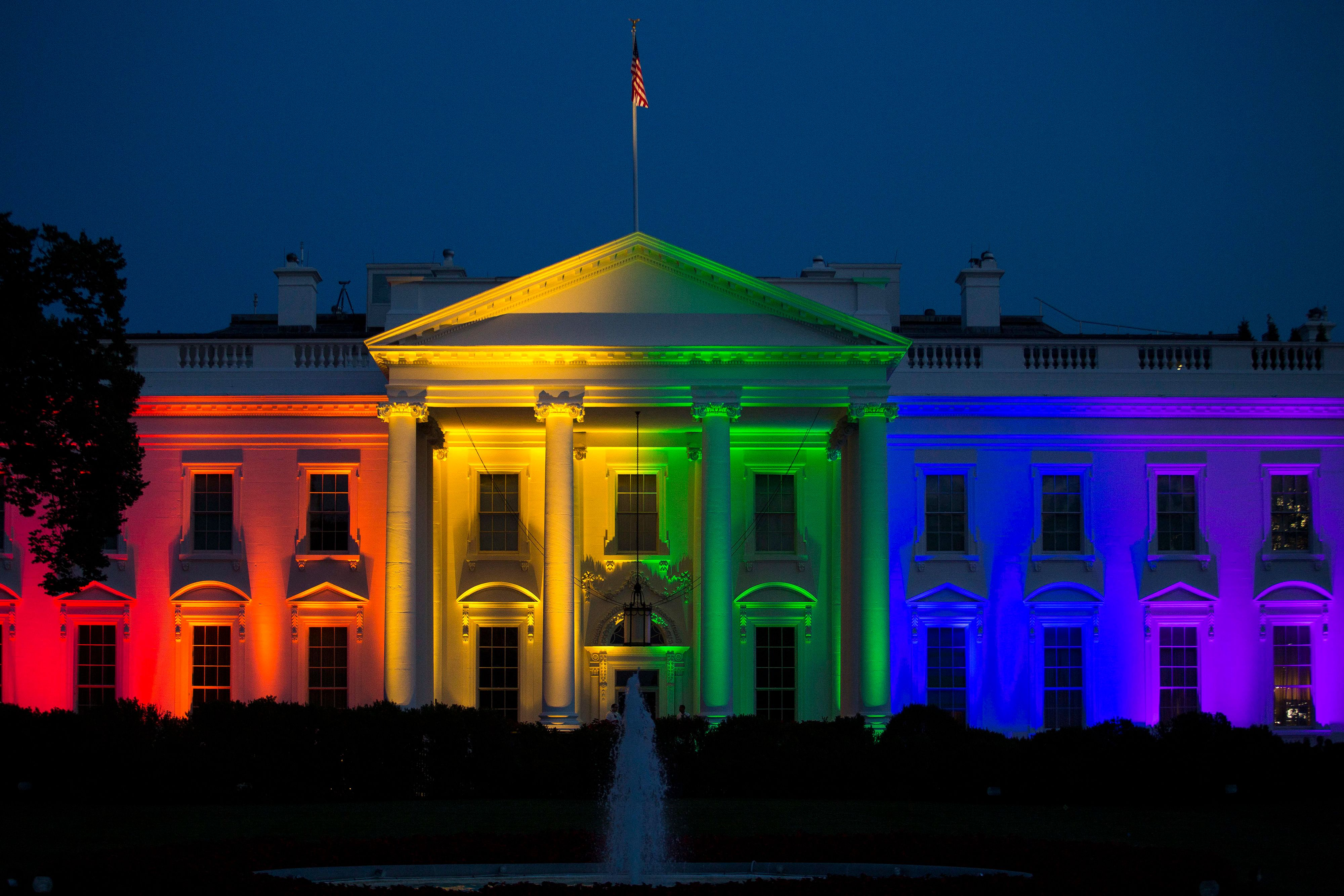 The White House stands illuminated in rainbow colored light at dusk in Washington, D.C., U.S., on Friday, June 26, 2015. The Supreme Court's ruling that gay marriage is legal nationwide is a 'victory for America,' U.S. President Barack Obama said today, declaring that justice had arrived for same-sex couples with 'a thunderbolt.' Photographer: Drew Angerer/Bloomberg via Getty Images