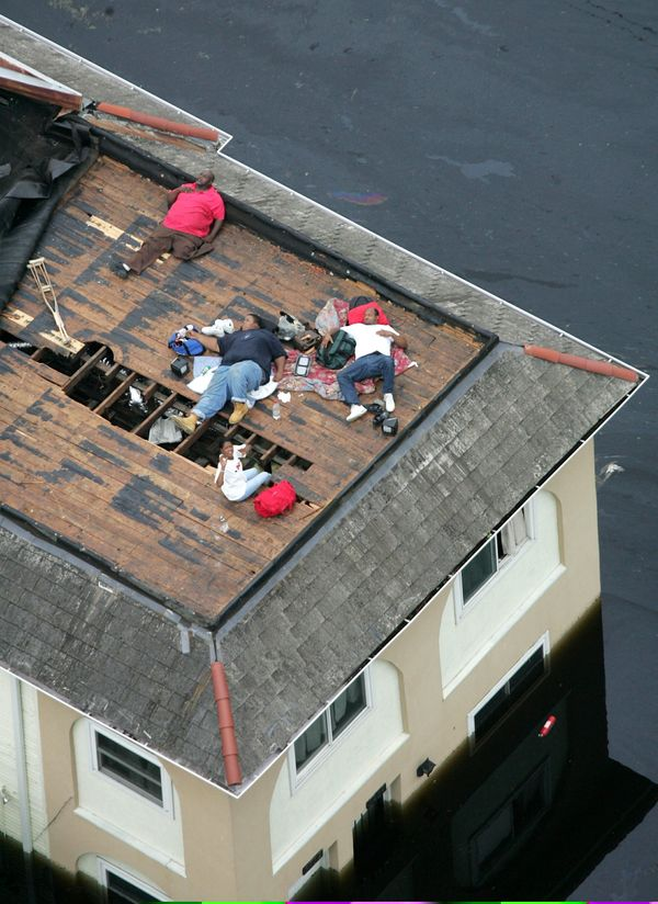 Residents wait on a rooftop to be rescued from the floodwaters of Hurricane Katrina in New Orleans, Sept. 1, 2005.