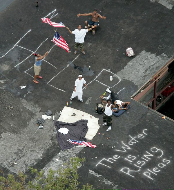 Residents wait to be rescued from the floodwaters of Hurricane Katrina in New Orleans, Sept. 1, 2005.