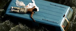 MAN ON ROOF OF CAR FLOOD WATERS HURRICANE KATRINA