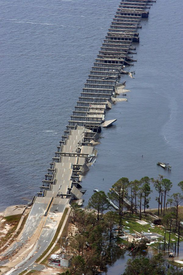 The Interstate 90 bridge over St. Louis Bay in Pass Christian, Mississippi, is folded and destroyed from the high wind and wa
