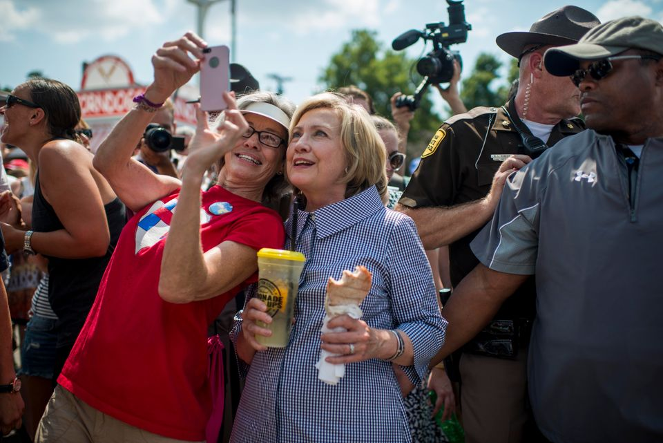 Hillary Clinton poses for photos with fans.