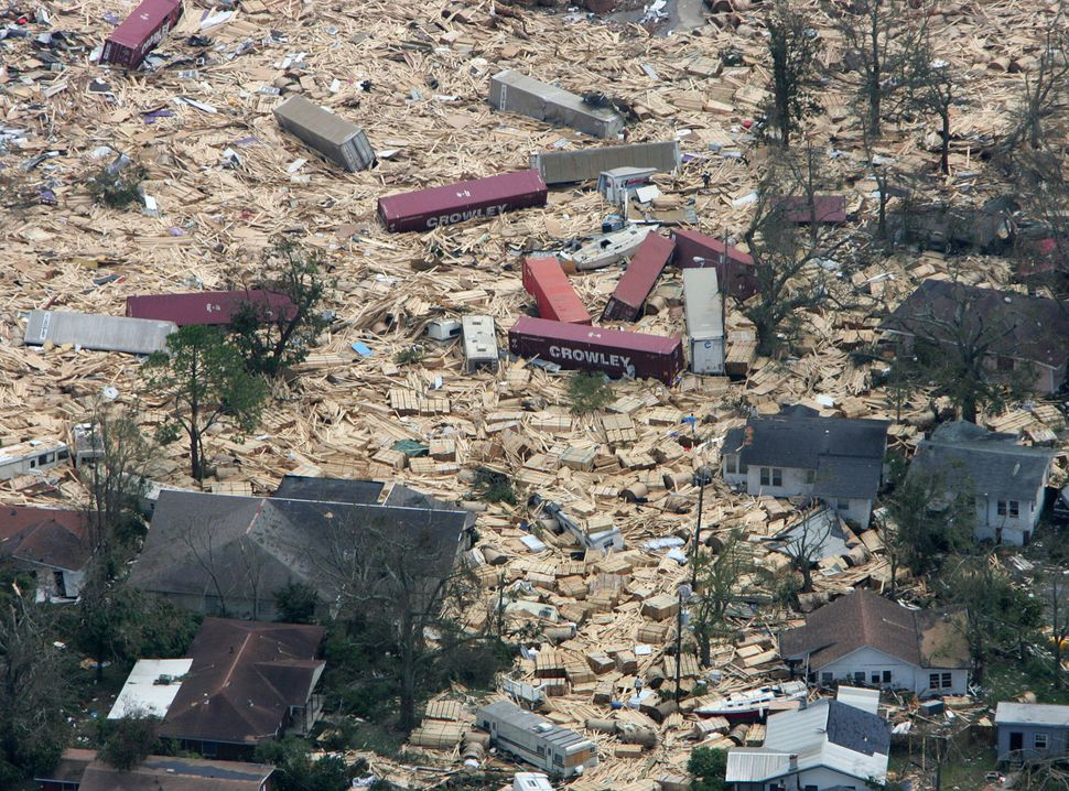A residential area inGulfport, Mississippi, is seen inundated withshipping containers, RVs and boats, all washed