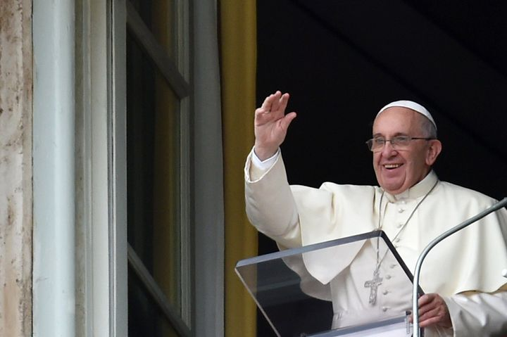 <span>Pope Francis waves to faithfuls gathered in St. Peter's Square following his Sunday Angelus prayer from the window of t