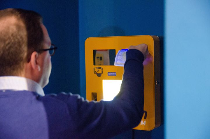 A man sends and receives payments with a Bitcoin machine in Gent, Belgium, on March 29, 2015.
