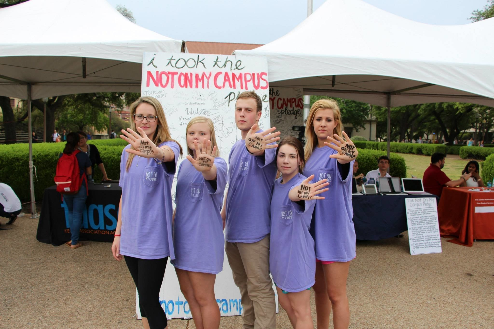 """Students at UT-Austin taking a """"Not On My Campus"""" pledge."""