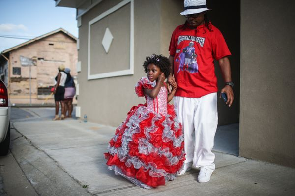 The 'Junior Queen' stands at the Original Big 7 Social Aid and Pleasure Club 'second line' parade on May 10, 2015 in New Orle