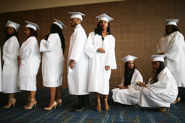 McDonogh #35 Senior High School graduates stand at their commencement at the Ernest N. Morial Convention Center on May 14, 20