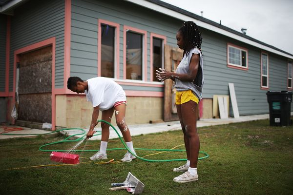 Ohio State student volunteers with lowernine.org help rebuild a home heavily damaged by Hurricane Katrina flooding in the Low