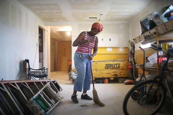 Esther Joseph sweeps in her flood damaged home which is still being rebuilt in the Lower Ninth Ward on May 15, 2015 in New Or