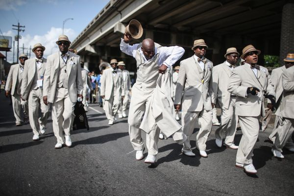 Club members march during the Zulu Social Aid and Pleasure Club 'second line' parade on May 17, 2015 in New Orleans, Louisian
