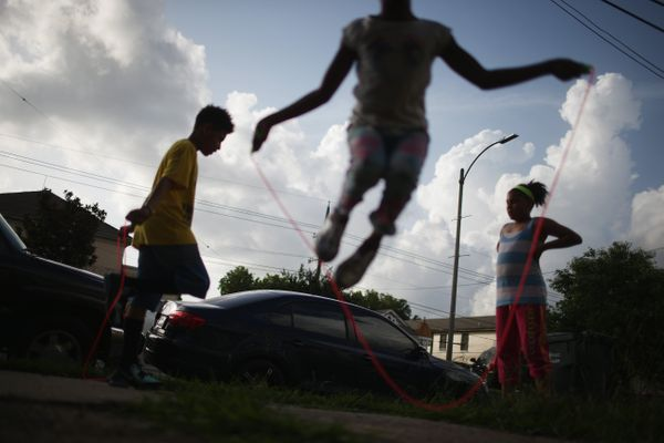Kids jump rope at the Sobaluavro family home at the conclusion of the Zulu Social Aid and Pleasure Club 'second line' parade