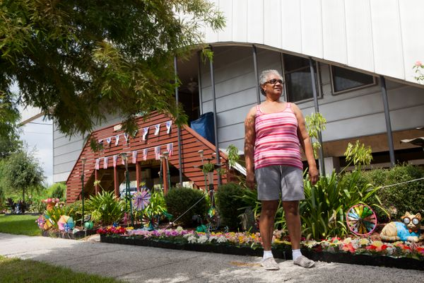 Mary Picot looks stands in front of her home near a levee in the Lower Ninth Ward, on July 22, 2015 in New Orleans, Louisiana
