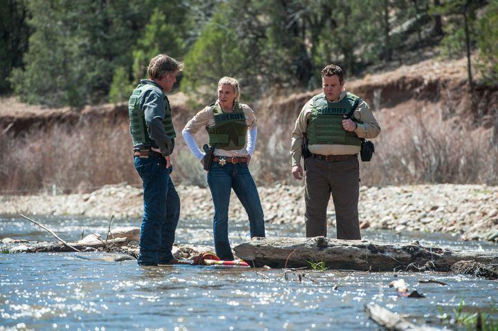 <span>Sheriff Walt Longmire (Robert Taylor) and his deputies, Vic Moretti (Katee Sackhoff) and The Ferg (Adam Bartley), inves