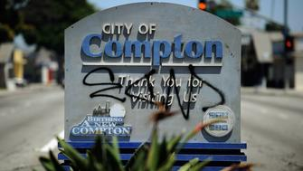 COMPTON, CA - JULY 19: A Compton city sign is tagged with graffiti on July 19, 2012 in Compton, California.  The City of Compton located south of Los Angeles with a population of nearly 100,000 must decide by September 1 whether to file for bankruptcy. According to city officials, Compton has an accumulated $43 million deficit and will run out of cash to make its payroll on September 1.  (Photo by Kevork Djansezian/Getty Images)