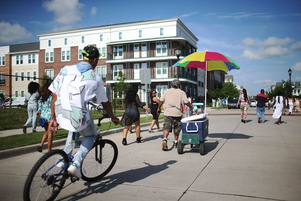 People gather in the community that was formerly the St. Bernard housing projects, which flooded during Hurricane Katrina, on