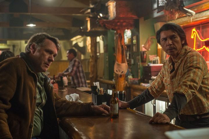 <span>Walt and Henry Standing Bear (Lou Diamond Phillips) meet up at Henry's bar, the Red Pony.</span>