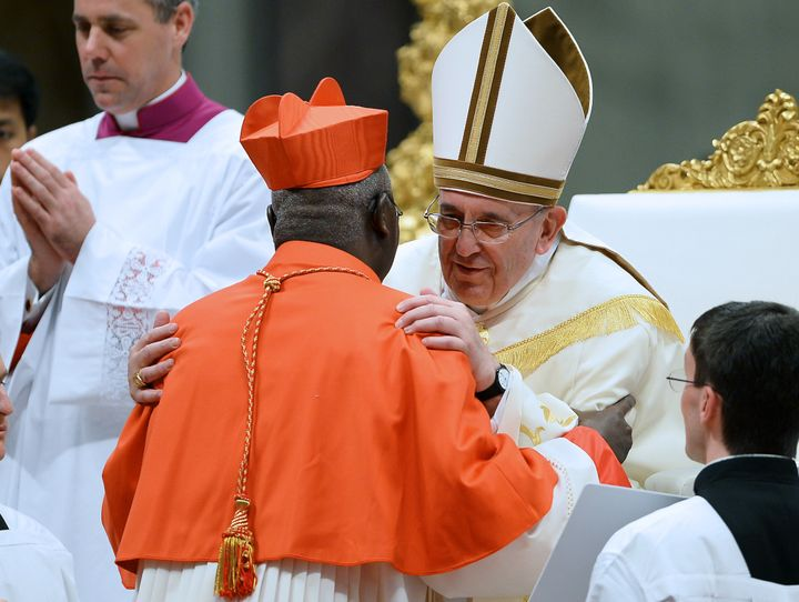 <span><span>Pope Francis embraces Cardinal Philippe Ouedraogo of Burkina Faso.</span></span>