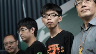 (L-R) Benny Tai of prominent pro-democracy group Occupy Central and Hong Kong student leaders Alex Chow, Joshua Wong and Alan Leong, of the Civic Party attend a press conference at the pro-democracy protesters camp site in the Admiralty district of Hong Kong on October 26, 2014. Hong Kong's pro-democracy protesters were on October 26 forced to suspend a planned vote on their next steps -- hours before it was due to begin -- due to differing opinions about how to move their month-long campaign forward. AFP PHOTO/ Nicolas ASFOURI        (Photo credit should read NICOLAS ASFOURI/AFP/Getty Images)