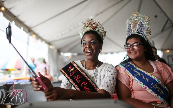 Visiting pageant queens from other Louisiana towns pose for a photo at the Plaquemines Parish Seafood Festival Queen pageant