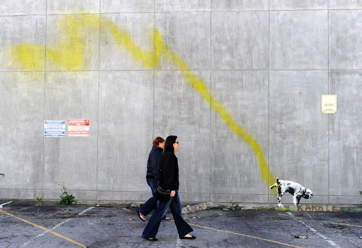 Image of urinating dog accredited to Banksy.