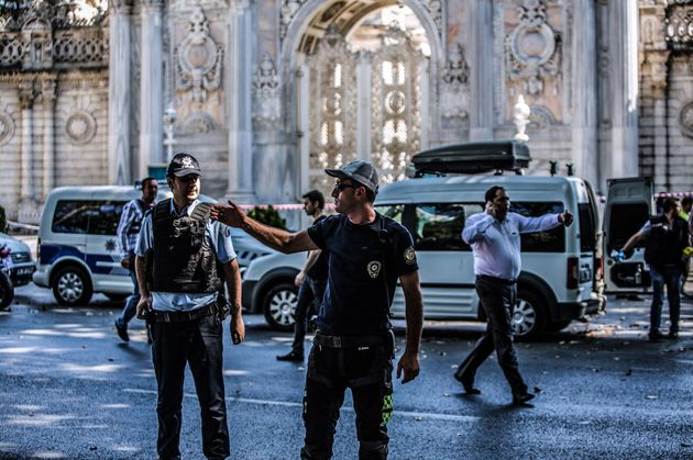 Turkish police officers work at the site where shots were fired at police officers on Aug.19, 2015...