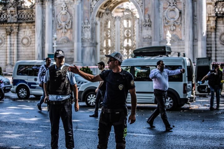 Turkish police officers work at the site where shots were fired at police officers on Aug. 19, 2015 at Dolmabahce palace